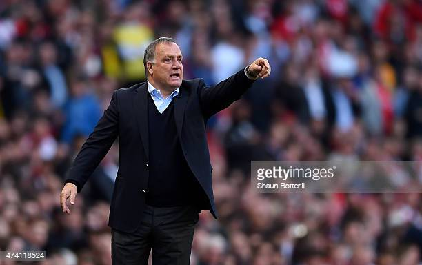 Dick Advocaat manager of Sunderland looks on during the Barclays Premier League match between Arsenal and Sunderland at Emirates Stadium on May 20...