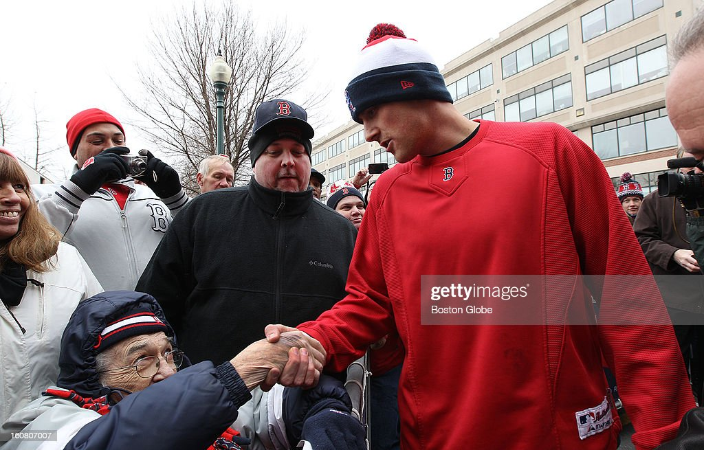 Dick Arundel, 76, of Salem, who was accompanied by three generations of his family (he is the fourth), is greeted by third baseman Will Middlebrooks. The Red Sox equipment truck gets packed and leaves Boston for Florida, on Tuesday, Feb. 5, 2013.