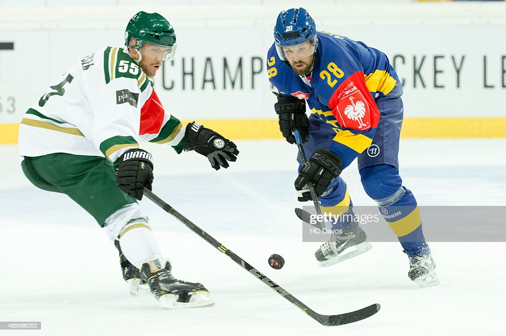 Dick Axelson #28 of Davos tries to trick the defenceman <a gi-track='captionPersonalityLinkClicked' href=/galleries/search?phrase=Ole-Kristian+Tollefsen&family=editorial&specificpeople=2129687 ng-click='$event.stopPropagation()'>Ole-Kristian Tollefsen</a> #55 of karlstad during the Champions Hockey League group stage game between HC Davos and Farjestad Karlstad on August 28, 2015 in Davos, Switzerland.