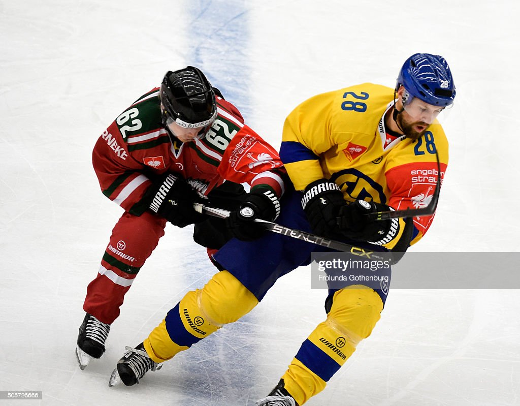 Dick Axelsson of HC Davos and <a gi-track='captionPersonalityLinkClicked' href=/galleries/search?phrase=Artturi+Lehkonen&family=editorial&specificpeople=9619074 ng-click='$event.stopPropagation()'>Artturi Lehkonen</a> of HC Davos in action during the Champions Hockey League semi final between Frolunda Gothenburg and HC Davos at Frolundaborgs Isstadion on January 19, 2016 in Gothenburg, Sweden.