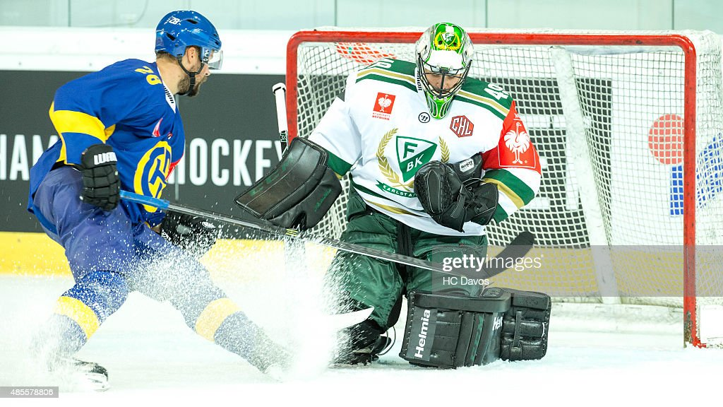 Dick Axelssson #28 of Davos challenges Farlestad Goalie <a gi-track='captionPersonalityLinkClicked' href=/galleries/search?phrase=Lars+Haugen&family=editorial&specificpeople=7718894 ng-click='$event.stopPropagation()'>Lars Haugen</a> #30 during the Champions Hockey League group stage game between HC Davos and Farjestad Karlstad on August 28, 2015 in Davos, Switzerland.