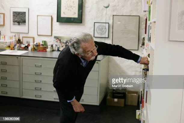 Dick Bruna author of the Miffy books artist illustrator and graphic designer looking through his bookshelf in his studio Utrecht The Netherlands 2nd...