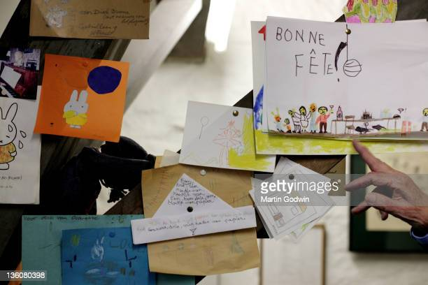 Dick Bruna author of the Miffy books artist illustrator and graphic designer showing Miffy artwork and fan mail from children in his studio Utrecht...