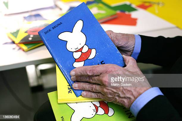 Dick Bruna author of the Miffy books artist illustrator and graphic designer opeining one of his books in his studio Utrecht The Netherlands 2nd...