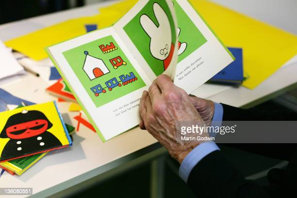 Dick Bruna author of the Miffy books artist illustrator and graphic designer holding one of his books in his studio Utrecht The Netherlands 2nd...