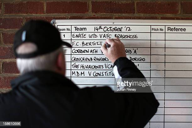 Dick Caylor the league officer writes the fixtures on the changing room board at Hackney Marshes on October 14 2012 in London England Hackney Marshes...