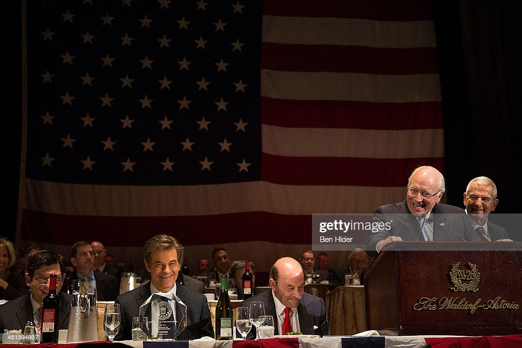Dick Cheney speaks as Dr. Mehmet Oz (L) attends 2013 Federal Law Enforcement Foundation Luncheon at The Waldorf=Astoria on November 22, 2013 in New York City.