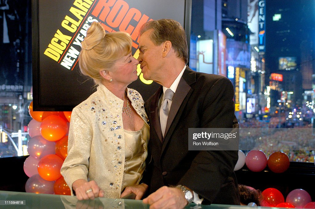Dick Clark plants his traditional New Year's kiss on his wife Kari Clark just after his countdown to midnight during his annual 'New Year's Rockin'...