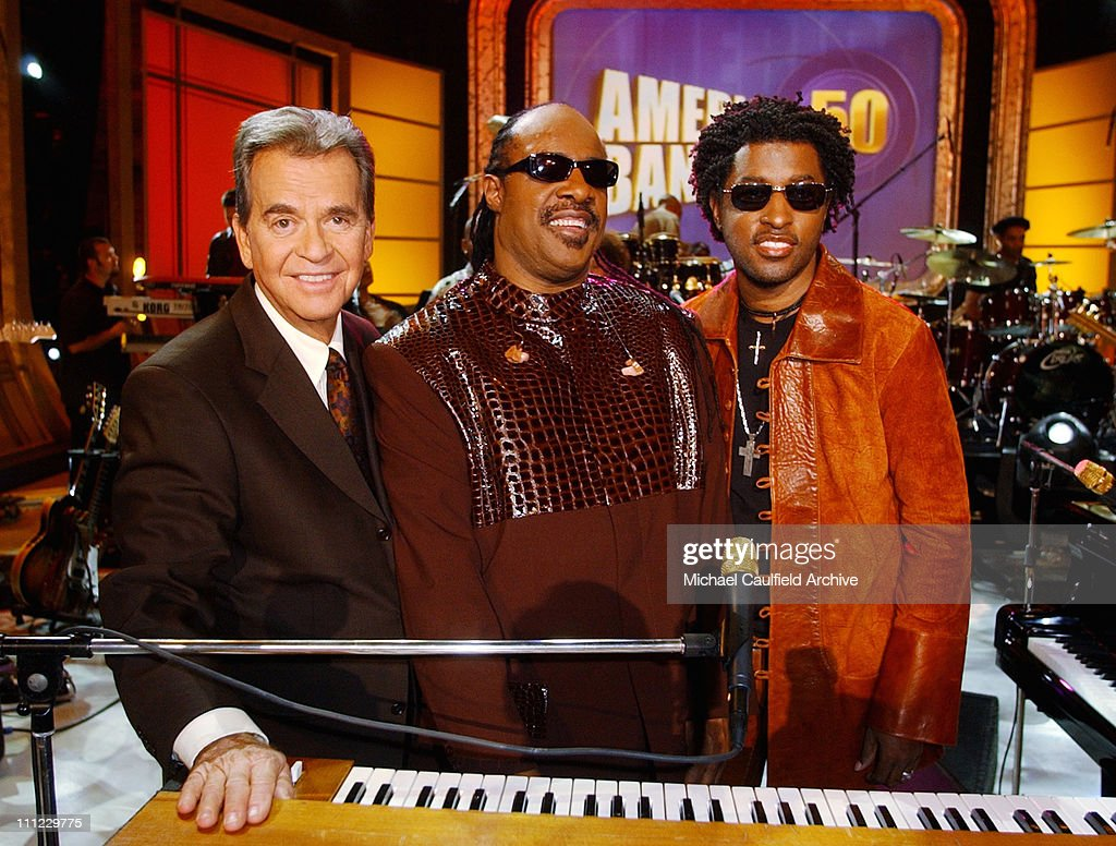 <a gi-track='captionPersonalityLinkClicked' href=/galleries/search?phrase=Dick+Clark&family=editorial&specificpeople=213041 ng-click='$event.stopPropagation()'>Dick Clark</a>, <a gi-track='captionPersonalityLinkClicked' href=/galleries/search?phrase=Stevie+Wonder&family=editorial&specificpeople=171911 ng-click='$event.stopPropagation()'>Stevie Wonder</a> and Kenny '<a gi-track='captionPersonalityLinkClicked' href=/galleries/search?phrase=Babyface&family=editorial&specificpeople=227435 ng-click='$event.stopPropagation()'>Babyface</a>' Edmonds at the taping of the 'American Bandstand's 50th...A Celebration!', to air on ABC TV May 3, 2002.