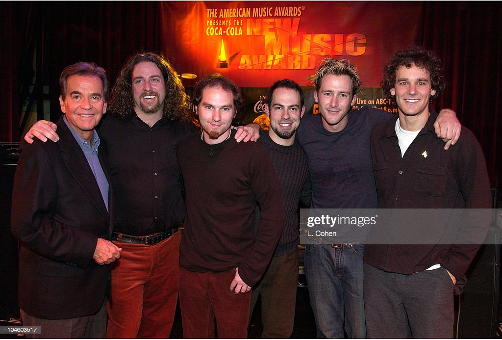 <a gi-track='captionPersonalityLinkClicked' href=/galleries/search?phrase=Dick+Clark&family=editorial&specificpeople=213041 ng-click='$event.stopPropagation()'>Dick Clark</a> with Carbon Leaf, winners of the American Music Awards Presents the Coca-Cola New Music Award.