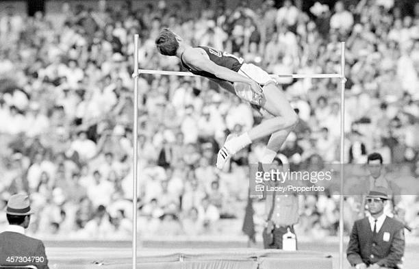 Dick Fosbury of the United States employs the Fosbury Flop to win the gold medal in the high jump event during the Summer Olympic Games circa October...