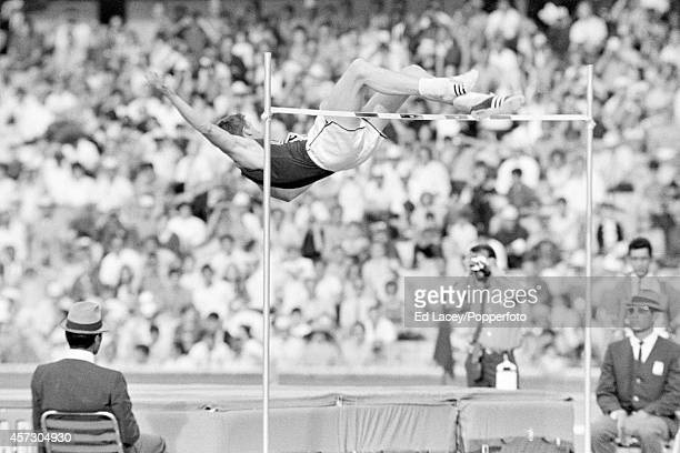 Dick Fosbury of the United States employs the Fosbury Flop to win the gold medal in the high jump event during the Summer Olympic Games in Mexico...