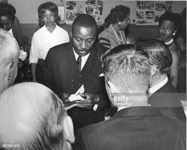 Dick Gregory with unidentified fans Credit Denver Post