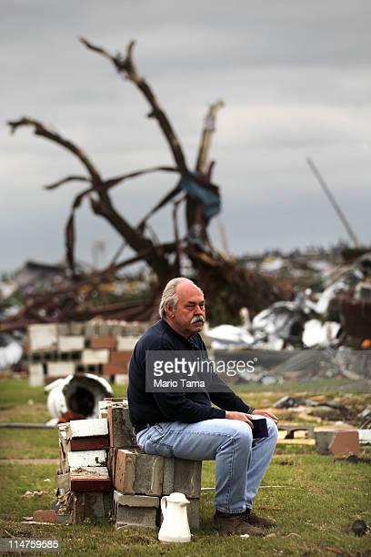Dick Hibdon waits for his insurance agent to arrive at the ruins of his business which was destroyed when a massive tornado passed through the town...