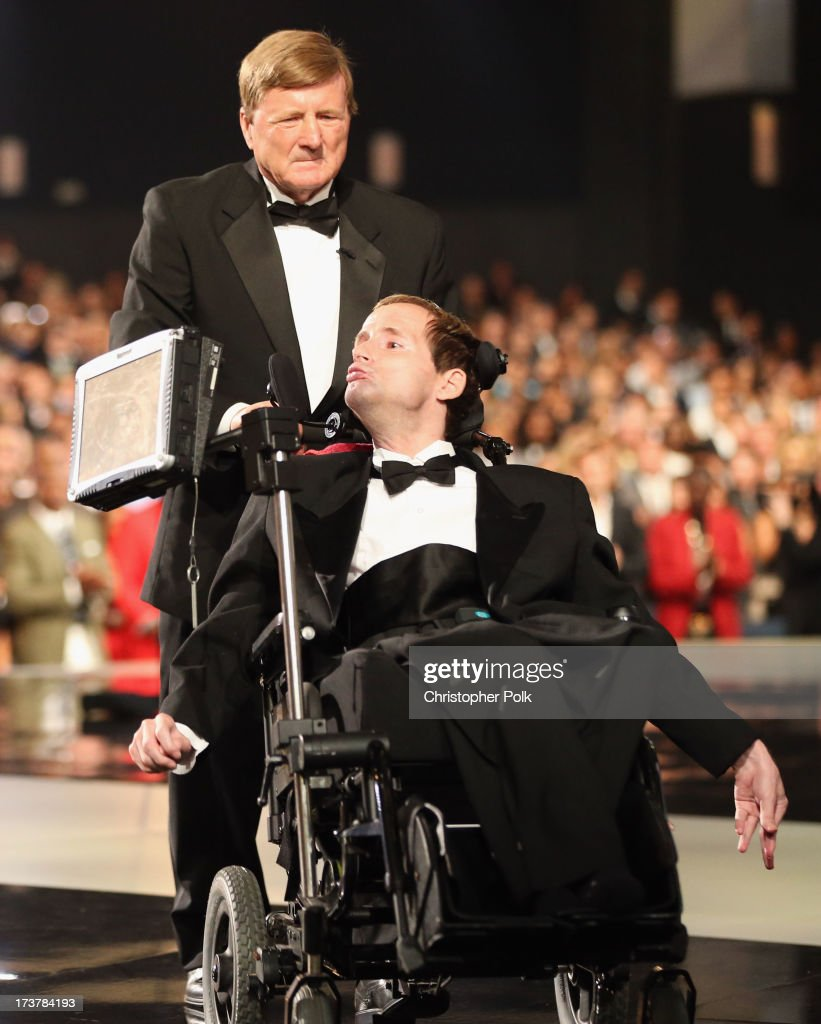 Dick Hoyt (L) and son Rick Hoyt of Team Hoyt accept the Jimmy V Award for Perseverance onstage at The 2013 ESPY Awards at Nokia Theatre L.A. Live on July 17, 2013 in Los Angeles, California.