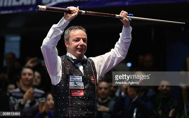 Dick Jaspers of Netherlands celebrates victory as he wins the World Cup after the final match of the Carom Billiards 3 Cushion World Cup against...