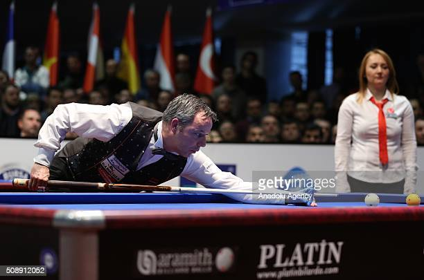 Dick Jaspers of Netherlands competes against Frederic Coudron of Belgium during the final match of the Carom Billiards 3 Cushion World Cup in Bursa...