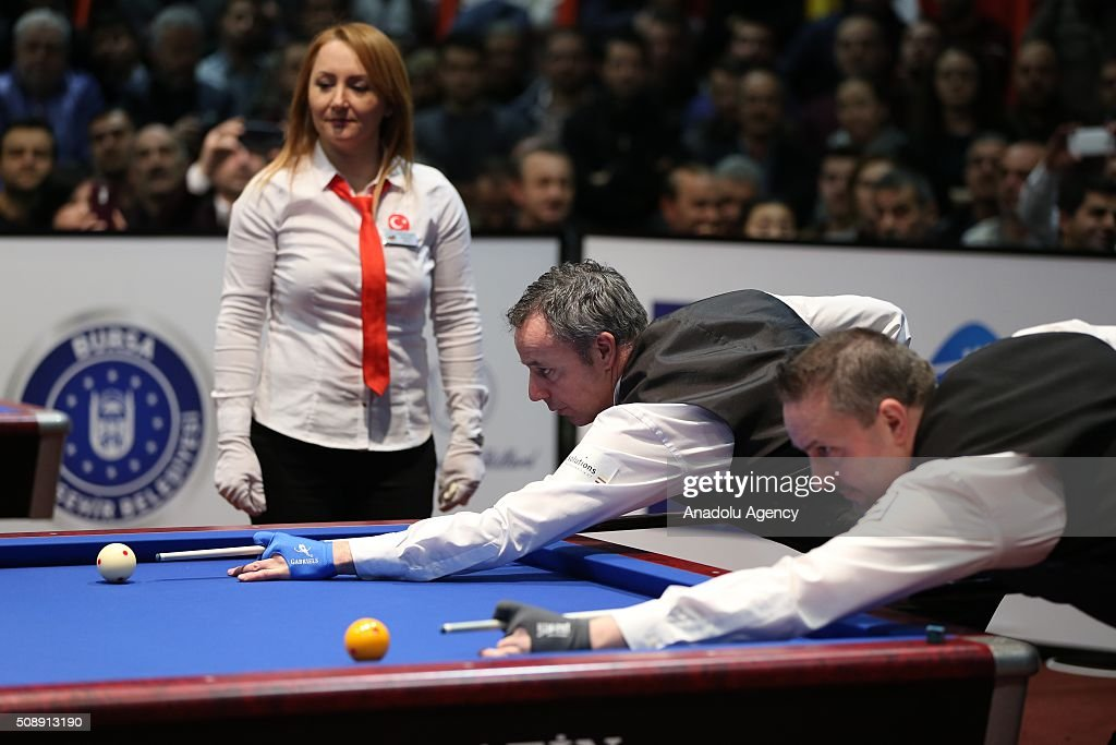 Dick Jaspers (L) of Netherlands competes against Frederic Coudron (R) of Belgium during the final match of the Carom Billiards 3 Cushion World Cup in Bursa, Turkey on February 7, 2016.