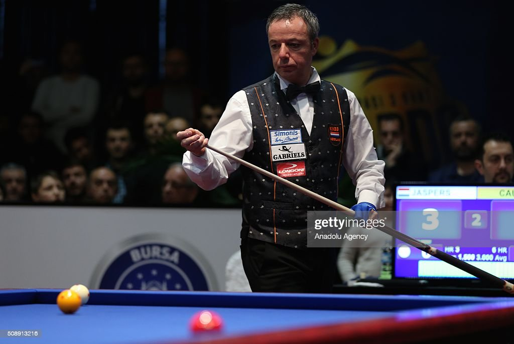 Dick Jaspers of Netherlands competes against Frederic Coudron (not seen) of Belgium during the final match of the Carom Billiards 3 Cushion World Cup in Bursa, Turkey on February 7, 2016.