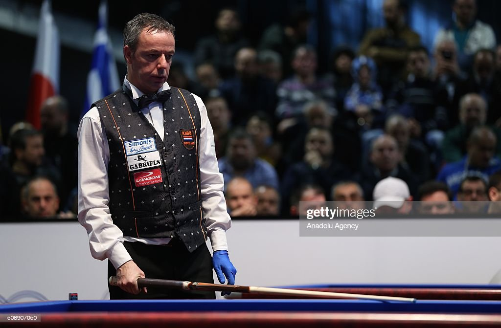 Dick Jaspers (C) of Netherlands competes against Pedra Piedrabuena of USA during 2nd match of semi-final of the Carom Billiards 3 Cushion World Cup in Bursa, Turkey on February 7, 2016.