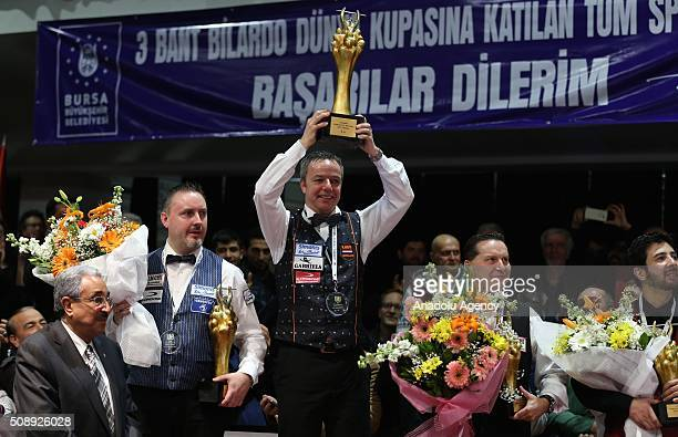Dick Jaspers of Netherlands poses with the World Cup as he become champion after the final match of the Carom Billiards 3 Cushion World Cup in Bursa...