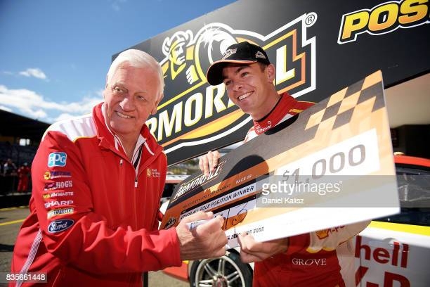 Dick Johnson team owner and Scott McLaughlin driver of the Shell VPower Racing Team Ford Falcon FGX pose for a photo after qualifying for race 18 of...