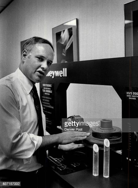 Dick Lane Gen Mgr of Honeywell Visitronics with an edge gauge which men tell width of pieces of metal Can tell when assembly line machines make...