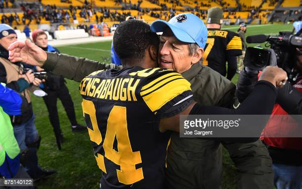 Dick LeBeau of the Tennessee Titans hugs Coty Sensabaugh of the Pittsburgh Steelers at the conclusion of the Pittsburgh Steelers 4017 win over the...