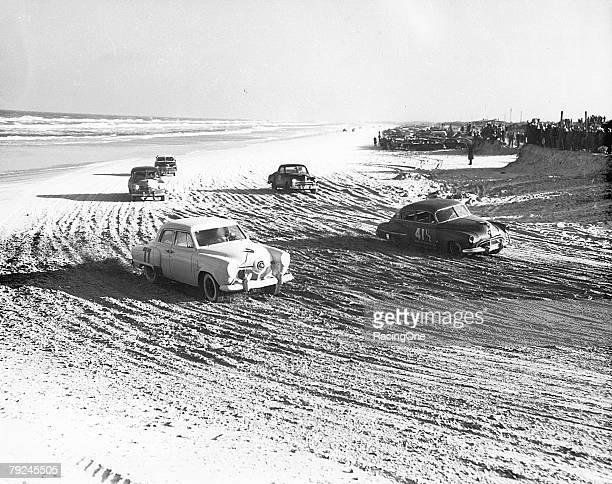 Dick Linder in the John Marcum Studebaker rounds the sandy beach turn next to Bill Blair on February 11 1951 in Daytona Beach Florida