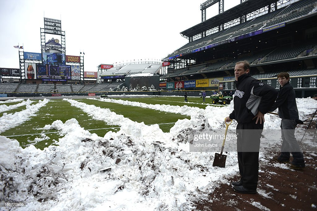 Dick Monfort, Owner, looks on as he takes a break from shoveling snow doen the right field line. Rockies grounds crew and employees work to clear the field of snow to get the first game of a double header in against the New York Mets April 16, 2013 at Coors Field.