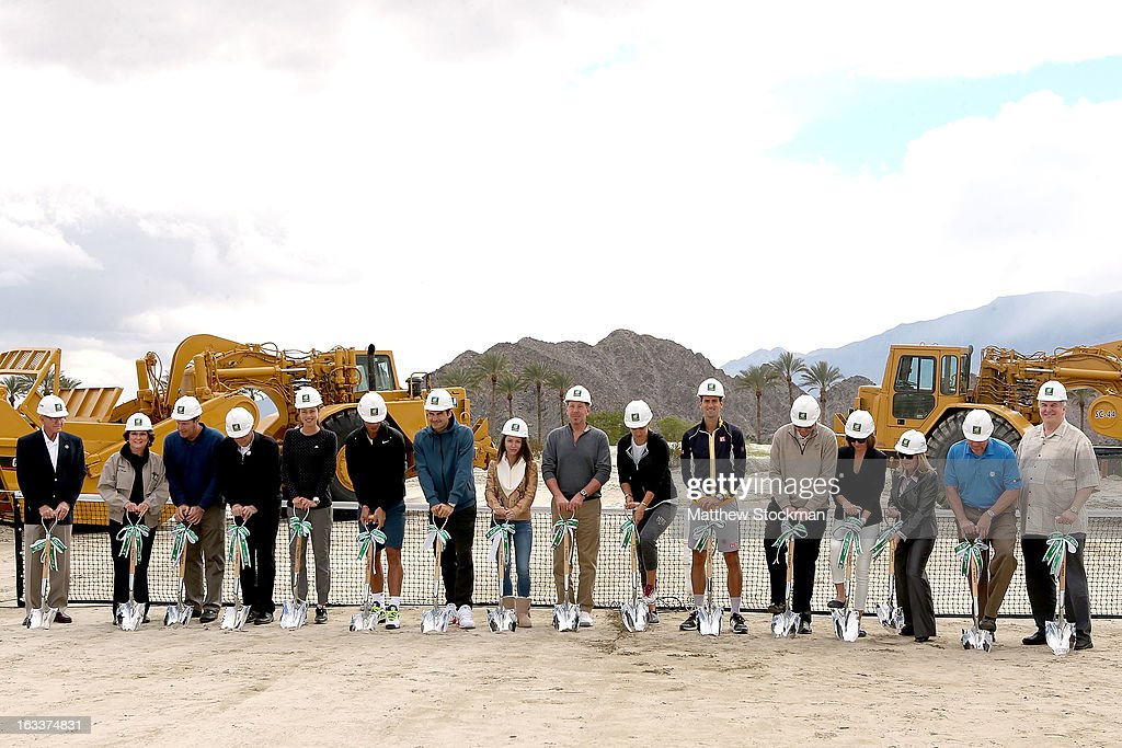 Dick Oliphant, Mary Roche, Mark Young, CEO of the ATP Americas, Raymond Moore, CEO of the BNP Paribas Open, Ana Ivanovic of Serbia, Rafael Nadal of Spain, Roger Federer of Switzerland, Nikita Kahn, Larry Ellison, tournament owner and CEO of Oracle, Victoria Azarenka of Belarus, Novak Djokovic of Serbia, Steve Simon, Michelle Sicard, Stacey Allaster, CEO of the WTA, Jody Watkins and Gary Wiggleparticipate in a ground breaking for the Indian Wells Tennis Garden expansion during the BNP Paribas Open at the Indian Wells Tennis Garden on March 8, 2013 in Indian Wells, California.