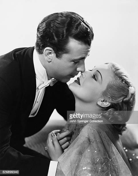 Dick Powell plays Gary Blake and Madeleine Carroll plays Mimi Caraway in the 1937 musical comedy On the Avenue