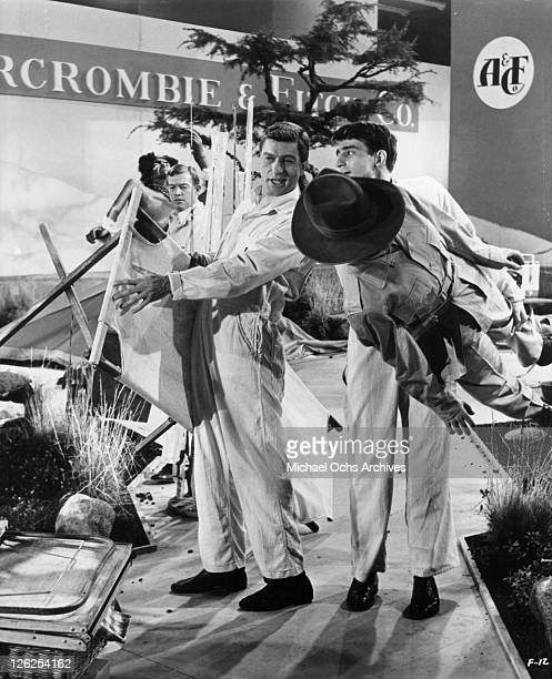 Dick Van Dyke and Sam Waterston arrange a display for Abercrombie and Fitch in a scene from the film 'Fitzwilly' 1967