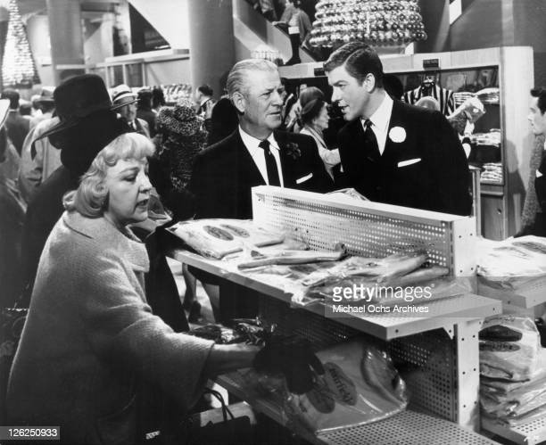 Dick Van Dyke speaks to John McGee before pulling off a gigantic robber7 in a scene from the film 'Fitzwilly' 1967