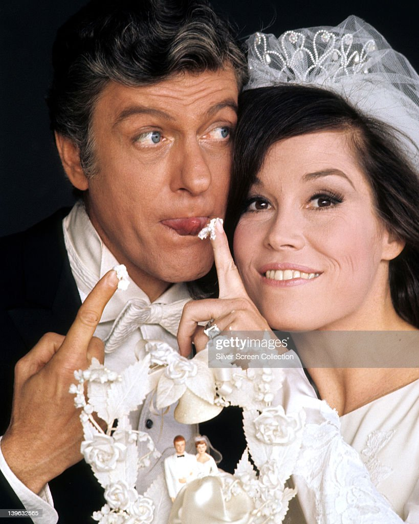 Dick Van Dyke, US actor, and Mary Tyler Moore, US actress, in a wedding dress, with a piece of icing from a wedding cake on her finger, in a publicity portrait issued for the US television special, 'Dick Van Dyke and the Other Woman', USA, 1969.
