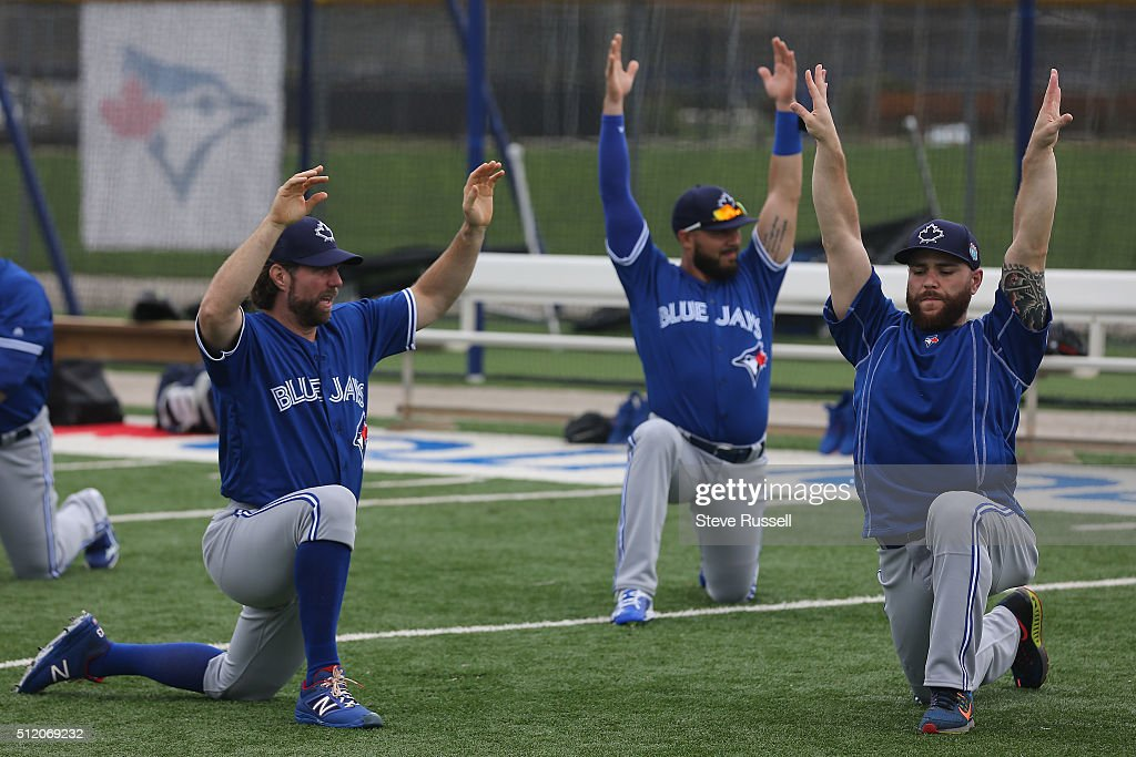R.A. Dickey and Russell Martin stretch. Toronto Blue Jays Spring Training for the 2016 Major League Baseball Season in Bobby Mattick Training Center at Englebert Complex in Dunedin. February 24, 2016.