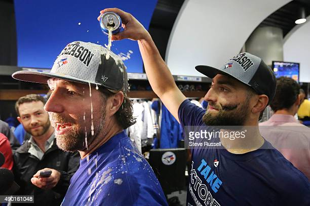 A Dickey gets a beer shower from Kevin Pillar as the playoff bound Toronto Blue Jays celebrate in their clubhouse after beating the Tampa Bay Rays...
