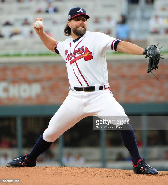 R A Dickey of the Atlanta Braves throws a first inning pitch against the San Diego Padres at SunTrust Park on April 14 2017 in Atlanta Georgia All...