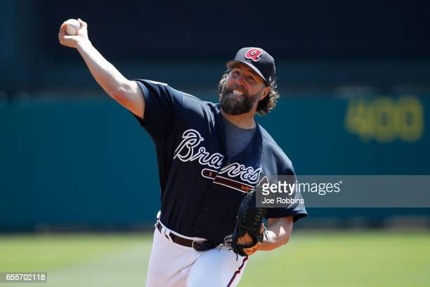 A Dickey of the Atlanta Braves throws a warm up pitch before the second inning of a Grapefruit League spring training game against the Miami Marlins...