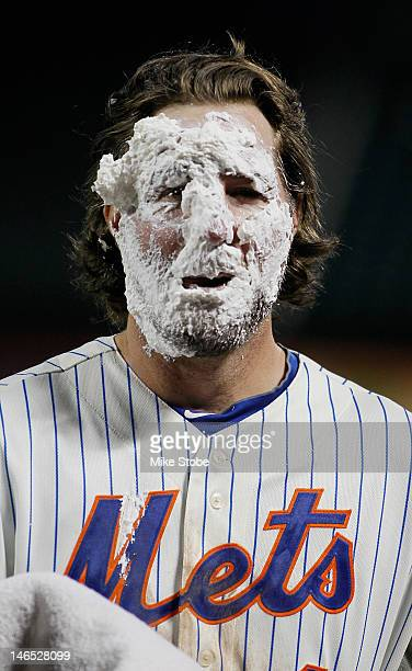 A Dickey of the New York Mets gets a shaving cream pie in the face after pitching a complete game one hitter against the Baltimore Orioles at Citi...