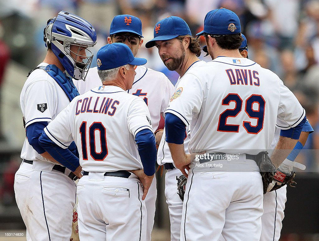 R.A. Dickey #43 of the New York Mets speaks with teammates during his 20th win of the season against the Pittsburgh Pirates at Citi Field on September 27, 2012 in the Flushing neighborhood of the Queens borough of New York City.