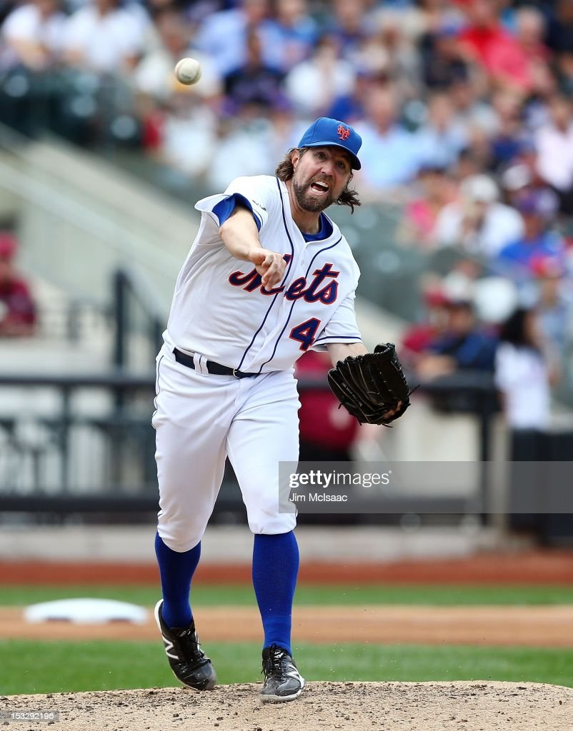 R.A. Dickey #43 of the New York Mets throws to first base against the Pittsburgh Pirates at Citi Field on September 27, 2012 in the Flushing neighborhood of the Queens borough of New York City. The Mets defeated the Pirates 6-5..