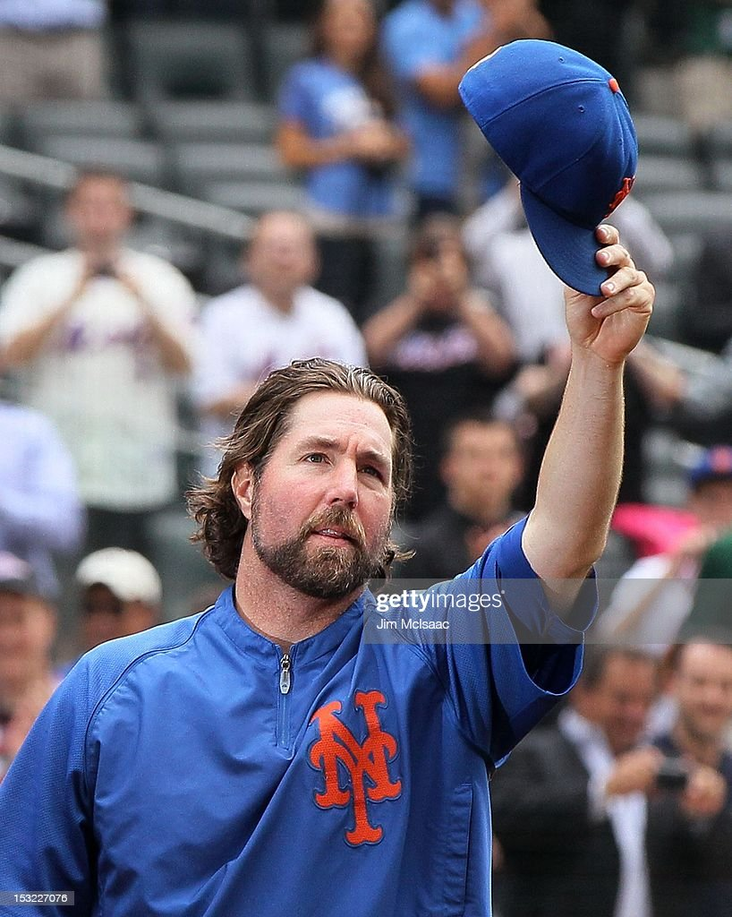 R.A. Dickey #43 of the New York Mets tips his cap to the crowd after the game against the Pittsburgh Pirates at Citi Field on September 27, 2012 in the Flushing neighborhood of the Queens borough of New York City. The Mets defeated the Pirates 6-5 and Dickey earned his 20th victory of the season.