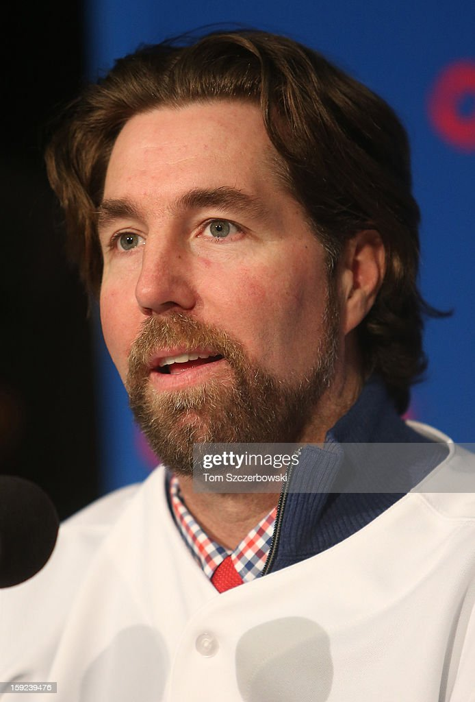 R.A. Dickey #43 of the Toronto Blue Jays answers questions from reporters during his introduction at a press conference at Rogers Centre on January 8, 2013 in Toronto, Ontario, Canada.