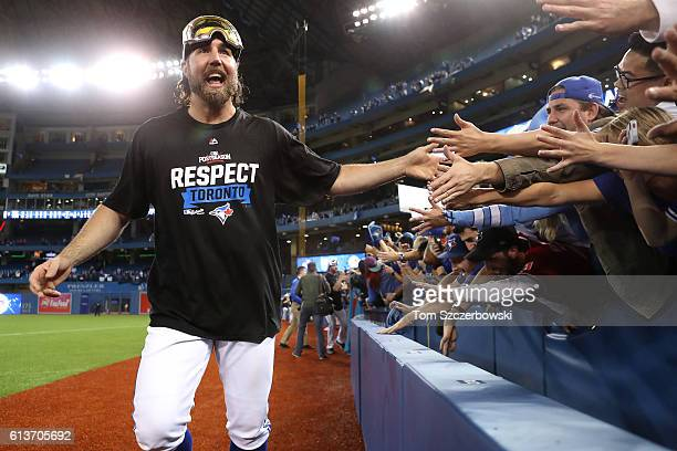 A Dickey of the Toronto Blue Jays celebrates with fans after the Toronto Blue Jays defeated the Texas Rangers 76 for game three of the American...