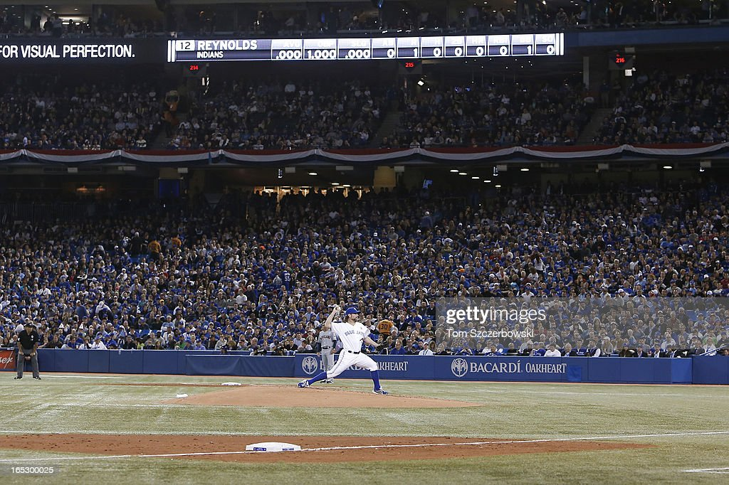 <a gi-track='captionPersonalityLinkClicked' href=/galleries/search?phrase=R.A.+Dickey&family=editorial&specificpeople=221719 ng-click='$event.stopPropagation()'>R.A. Dickey</a> #43 of the Toronto Blue Jays delivers a pitch during MLB game action on Opening Day against the Cleveland Indians on April 2, 2013 at Rogers Centre in Toronto, Ontario, Canada.