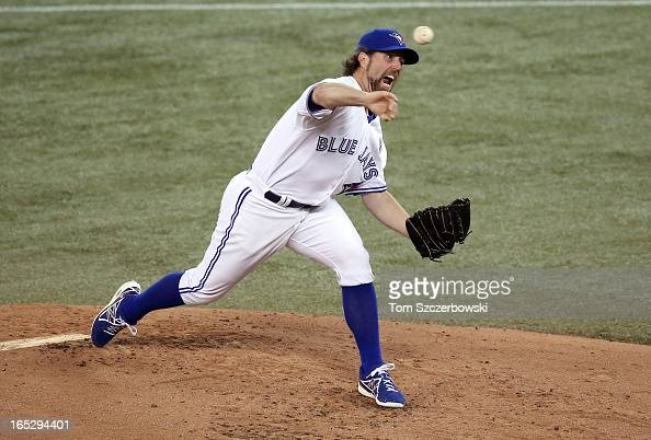 A Dickey of the Toronto Blue Jays delivers a pitch during MLB game action against the Cleveland Indians during Opening Day on April 2 2013 at Rogers...