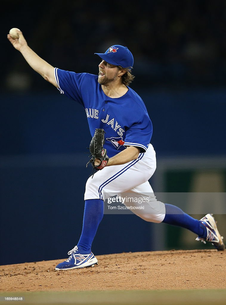 R.A. Dickey #43 of the Toronto Blue Jays delivers a pitch during MLB game action against the Boston Red Sox on April 7, 2013 at Rogers Centre in Toronto, Ontario, Canada.