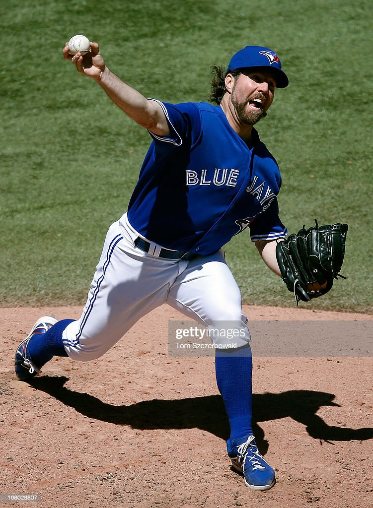R.A. Dickey #43 of the Toronto Blue Jays delivers a pitch during MLB game action against the Seattle Mariners on May 4, 2013 at Rogers Centre in Toronto, Ontario, Canada.