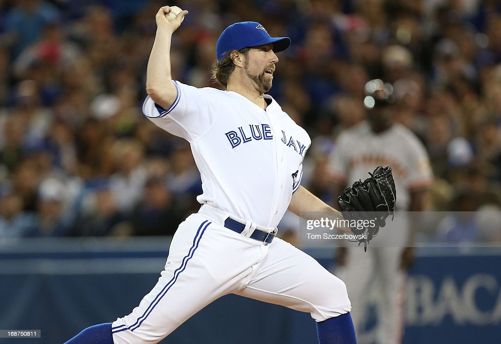<a gi-track='captionPersonalityLinkClicked' href=/galleries/search?phrase=R.A.+Dickey&family=editorial&specificpeople=221719 ng-click='$event.stopPropagation()'>R.A. Dickey</a> #43 of the Toronto Blue Jays delivers a pitch during MLB game action against the San Francisco Giants on May 14, 2013 at Rogers Centre in Toronto, Ontario, Canada.